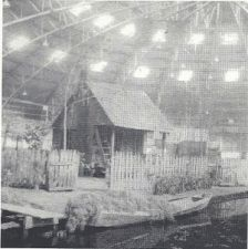 A Cajun cottage in the Blackham Coliseum in Lafayette, LA, as part of the SLI convention ca 1948